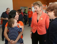 Provincial Nickel Belt NDP candidate France Gelinas, middle, chats with Miyako Chen and her son, Curtis, 19 months, and Marie Thompson at the opening of Gelinas' campaign office in Val Caron on Friday. John Lappa/Sudbury Star/Postmedia Network