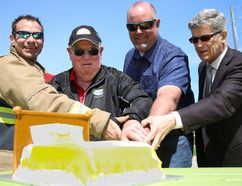 Tim Miller/The Intelligencer (From left) Quinte West firefighter Duty Captain Chris Wigley, Mayor Jim Harrison, Mike Eden of Leon's Trenton and Trenton Memorial Hospital Foundation chairman Phil Wild cut a bed-shaped cake at the kickoff of the Leon's Trenton Buy-A-Bed Campaign on Saturday in Quinte West.