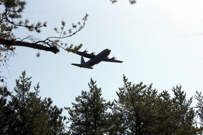 Sean Chase/Daily Observer  A C-130 Hercules flies directly over Wegner Point, the site of the worst peacetime training accident in Canadian history 50 years ago. The fly past was part of ceremonies honouring the seven paratroopers who drowned in the Ottawa River on the night of May 8, 1968.