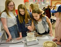 Students from Mayerthorpe High learn to make their own lip balms at the Tiger Summit on May 8. (Taryn Brandell | Mayerthorpe Freelancer)
