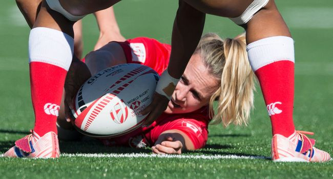 Canada's Julia Greenshields of Sarnia, Ont., tries to hold on to the ball during a match against Ireland at the World Women's Rugby Sevens Series in Langford, B.C., on Saturday, May 12, 2018. (Jonathan Hayward/The Canadian Press)
