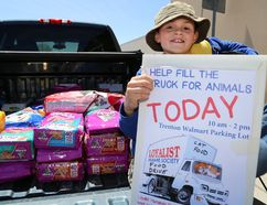 Intelligencer file photo Christopher Casey sits on the tailgate of a truck partially filled with cat food and supplies in the Walmart parking lot on Saturday, May 20, 2017 in Trenton. Casey was collecting donations for the Loyalist Humane Society, a venture he will be repeating this year on Saturday.