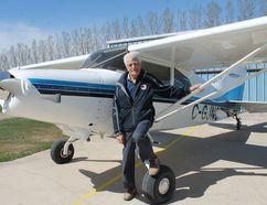 John Carley poses with his Maule at the Carman Airport. It's one of the few planes you can still buy with a tail wheel, which makes it a little more challenging to fly, but it's the kind of plane Carley trained on in 1958. (EMILY DISTEFANO)