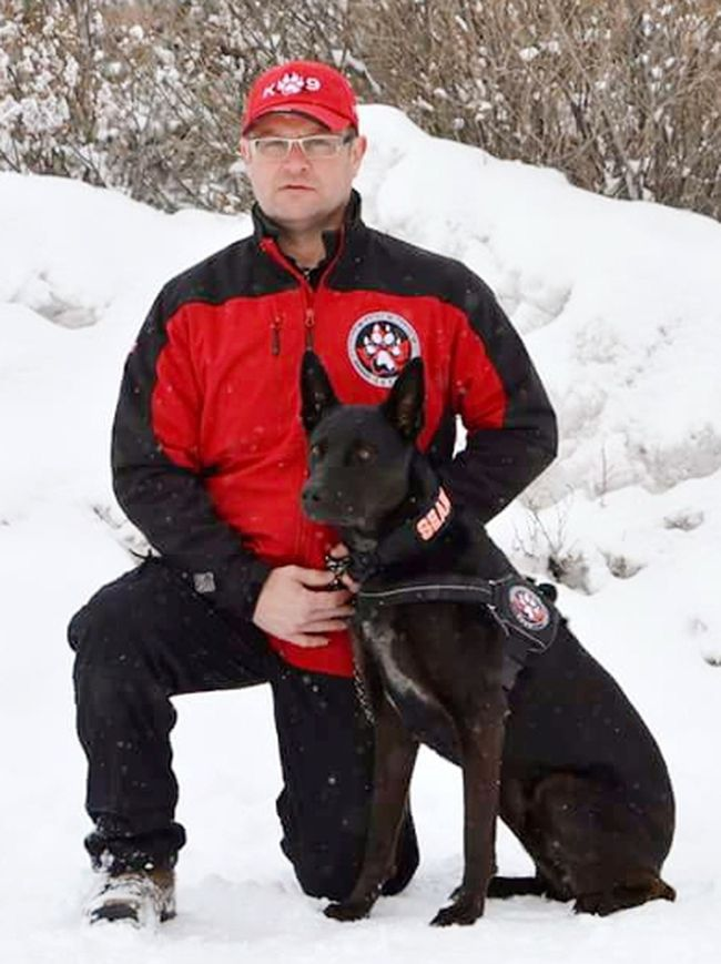 Brian Harmes with Koda who works as a cadaver dog, volunteering for the Canadian Canine Search Corps.