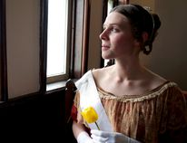 Historical interpreter Jessica Fraser, dressed as a young Queen Victoria, gazes out a church window at Fanshawe Pioneer Village. The attraction at Fanshawe Conservation Area continues a long-standing tradition this long weekend by celebrating Queen Victoria's birthday. (CHRIS MONTANINI\LONDONER)