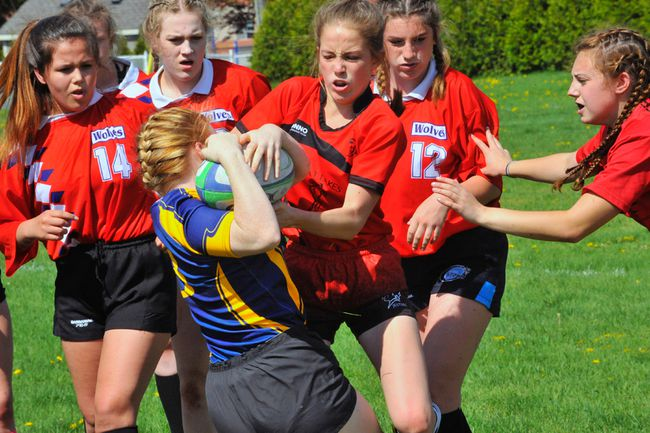 Alex Mackay of Waterford and Delhi's Calissa Nowe battle for posession of the ball during the NSSAA rugby semi-finals Tuesday at WDHS. The Wolves scored two late tries to win the game 15-14. JACOB ROBINSON/Simcoe Reformer