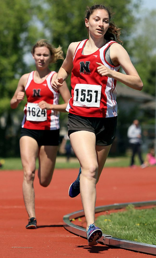 Caroline Forbes of the Northern Vikings leads teammate Kaylee White during the senior girls' 1,500 metres at the LKSSAA track and field meet at the Chatham-Kent Community Athletic Complex in Chatham, Ont., on Tuesday, May 15, 2018. Forbes won in 4:54.72 and White was second in 4:56.09. (MARK MALONE, Postmedia Network)