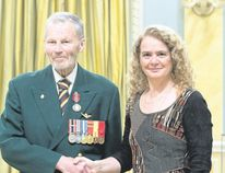 Garry Hunt (left) receives Sovereign's Medal for Volunteers from the Governor General of Canada, Julie Payette (right) on April 17 in Ottawa.