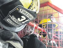 A stall with gear for Canmore firefighters. The helmet belongs to firefighter Hutchison, a dedicated part-time firefighter for years before becoming full-time, fire chief Walter Gahler notes.