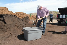 Rigo Jascher collects compost that he plans to use to plant potatoes with his wife.