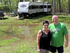 Tracey and Duane Cowen will be high and dry in their camper trailer, but the ground around their seasonal site at the C.M. Wilson Conservation Area, south of Chatham, Ont., is saturated with water. Despite the wet start to the camping season, the Chatham couple are looking forward to spending the season at the campground. Photo taken Wednesday May 16, 2018. (Ellwood Shreve/Chatham Daily News)