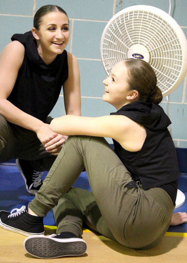 """Olivia Vecchio and Julia Lemieux cool off after joining about 18 other members of St. Mary's College's dance team to perform a hip hop routine for Huron-Superior Catholic District School Board trustees on Wednesday night at the former Mount St. Joseph College gym. The team, led by teacher moderator Tara Calvano, earned three top performances at Kick It Up dance competition in Mississauga in March. Team captains are Hunter Pozzebon and Kelsey Watson. Choreographers are Kiera Czop, Angela Murtha, Annina Trecroce and Vecchio. Pozzebon calls the team """"a group of girls who love to dance."""""""