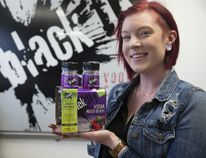 Black Fly Beverage Co. sales and marketing support administrator Charlotte Gooding displays their mixed berry vodka coolers that come with a one-time-use breathalyzer for a limited time. (Derek Ruttan/Postmedia Network)