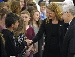 Julie Payette (Governor General of Canada) greets school children inside the Alberta Legislature during her first official visit to Alberta on Tuesday May 15, 2018. As part of the proceedings, Payette received military honours, including a 100-person guard of honour from the 3rd Battalion, Princess Patricia's Canadian Light Infantry, the Vice-Regal Salute and a 21-gun salute by the 20th Field Regiment, Royal Canadian Artillery. For only the second time in Alberta's history, the Governor General also addressed members of the legislative assembly in the chamber.