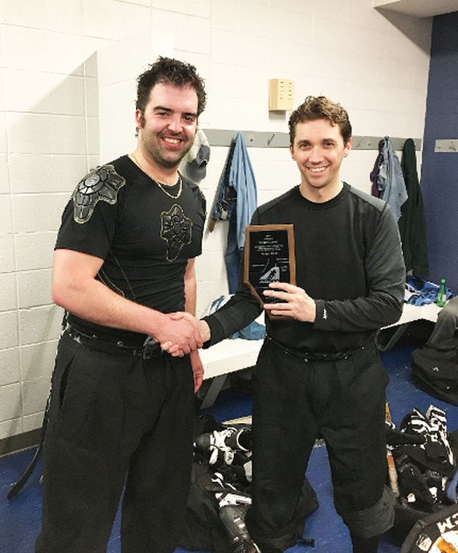 Scott Hennig, right, received a Hockey Alberta longtime and outstanding service award for his years of giving back to the sport of hockey.
