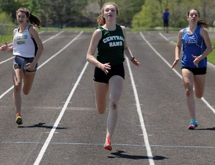 Stratford Central's Ashlynn Gilhula, middle, runs to a first-place finish in the midget girls 200m race at the Huron-Perth track and field championships Wednesday in Clinton. Gilhula won four gold medals at the two-day meet and qualified for WOSSAA next week in London. (Cory Smith/The Beacon Herald)