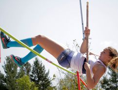 Anna Foreman Willms of the Kingston Blues sets a record of 2.60 metres in the senior girls pole vault at the Kingston Area Secondary Schools Athletic Association track and field championships at the CaraCo Home Field complex on Thursday. (Wyatt Brooks/For The Whig-Standard)