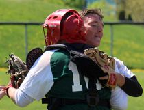 Nathaniel Van Putten embraces catcher Bailey Geneau after Holy Trinity's SD&G high school baseball championship at Legion Park on Friday. Van Putten pitched a no-hitter as Holy Trinity beat Seaway 5-0. Kevin Gould/Cornwall Standard-Freeholder