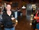 Morag Kloeze, owner and brewmaster at Mudtown Station brewpub and restaurant in Owen Sound, holds a flat of craft beers in the bar area of the newly-opened business. The business is located in the former Canadian Pacific Railway on Owen Sound's east harbour. (Rob Gowan The Sun Times)