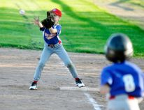 Abigayle Van Bakel at first base for one of the Mitchell Rookie baseball teams makes a catch while this batter hustles down the line during action from last Wednesday, May 16 at Keterson Park. ANDY BADER/MITCHELL ADVOCATE