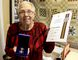 Gwen Robinson displays the Sovereign's Medal for Volunteers and accompanying certificate she received in the mail on Wednesday May 23, 2018. Ellwood Shreve/Chatham Daily News/Postmedia Network