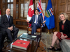 Forced smiles can't hide the tension as John Horgan and Rachel Notley meet with Prime Minister Justin Trudeau in April to try to work out a solution to the Trans Mountain pipeline impasse.