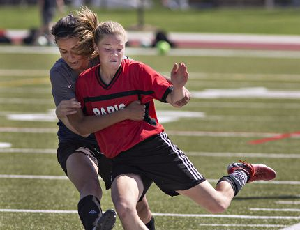 Layla Yunes of Assumption College tries to stop Taylor Schell of Paris District High School from passing the ball during the high school girls soccer championship game on Wednesday at Bisons Alumni North Park Sports Complex in Brantford. (Brian Thompson/The Expositor)