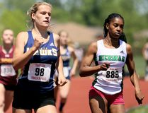 Payton Sabourin, left, of Chatham-Kent is challenged by Taneidra Cain of Herman during the senior girls' 400 metres at the SWOSSAA track and field championship at the Chatham-Kent Community Athletic Complex in Chatham, Ont., on Wednesday, May 23, 2018. (MARK MALONE/Chatham Daily News/Postmedia Network)