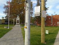 Brant County council is working on amending the sign bylaw to prohibit the placing of commercial signs on boulevards and lawns of memorial parks, cenotaphs and cemeteries. A sign placed by the county at Memorial Park in St. George does not seem to be working. (Submitted Photo)