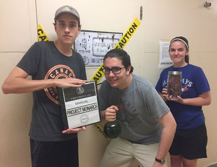 """Drama students William Sawyer, left, Andrew Bissonnette and Emily Taylor-Bond have been working hard with the rest of their class designing an """"escape room"""" at Arthur Voaden secondary school. The escape room challenges participants to solve a set of clues that will ultimately free them from the room. (Laura Broadley/Times-Journal)"""