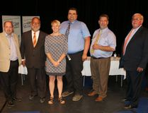Moderator Cheryl St. Amour of Timmins, centre, kept the discussion on track during the Timmins riding all-candidates debate held Wednesday night at O'Gorman High School. Candidates were, Yvan Génier, left, Gilles Bisson, Gary Schaap, Josef Bauer and Mickey Auger. The event was hosted by the Timmins Chamber of Commerce.