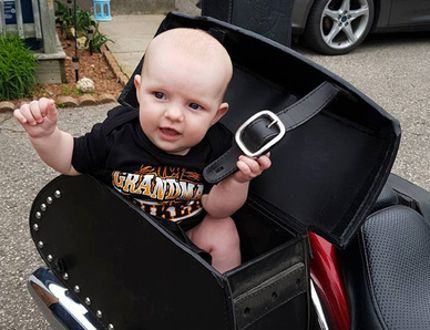 Columnist Kimberlee Taplay introduces her granddaughter, Isabelle, to her motorcycle, Ruby. (Submitted Photo)