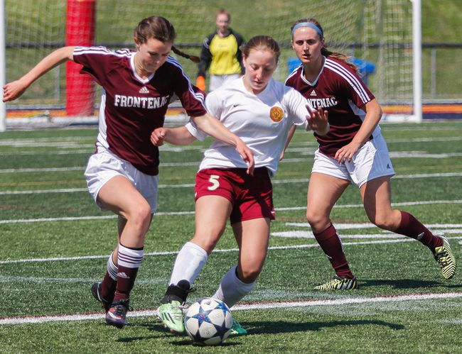 Regiopolis Notre-Dame Panthers' Kaleigh Coco keeps the ball moving away from Frontenac Falcons' Emma Young during the first half of the Kingston Area Secondary Schools Athletic Association senior girls soccer final at Richardson Stadium on Thursday. The Panthers won the game, 2-0. (Julia McKay/The Whig-Standard)
