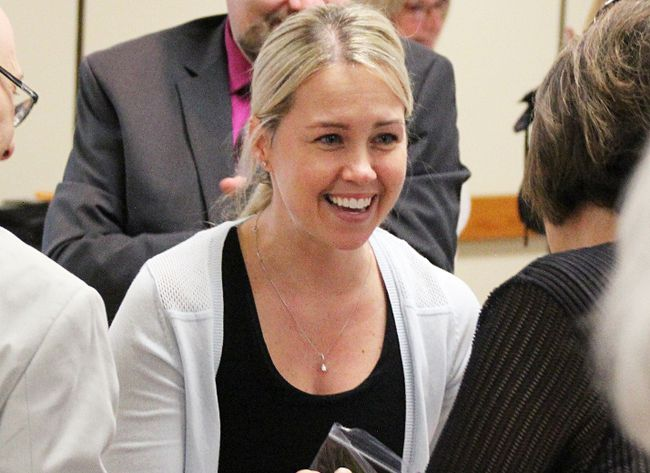 Dr. Jessica Bourassa says she was shocked to be named this year's Community Living Sarnia-Lambton Hero Award recipient. The Sarnia dentist, pictured smiling as she's congratulated on the award Friday, helps encourage people with disabilities to access dental care locally. Tyler Kula/Sarnia Observer/Postmedia Network