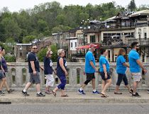 Participants in the Walk for Alzheimer's fundraiser cross the William Street bridge in downtown Paris on Saturday. (Brian Thompson/The Expositor)