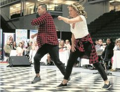 BRUCE BELL/THE INTELLIGENCER Carol and Chris Wiggins took top honours on Friday night at VIQ Dancing with the Stars Quinte. Close to 2,000 spectators watched the event's first mother/son team electrify the crowd at Yardmen Arena with their hip hop routine to Justin Timberlake's Can't Stop the Feeling.