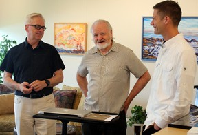 """Christian Fortin, left, Dermot Wilson and Richard Fortin talk about the inaugural exhibition of the Northern Ontario Visual Arts Hive, Monday, part of a new """"innovation and co-working hub"""" at the former Tweedsmuir Public School. PJ Wilson/The Nugget"""
