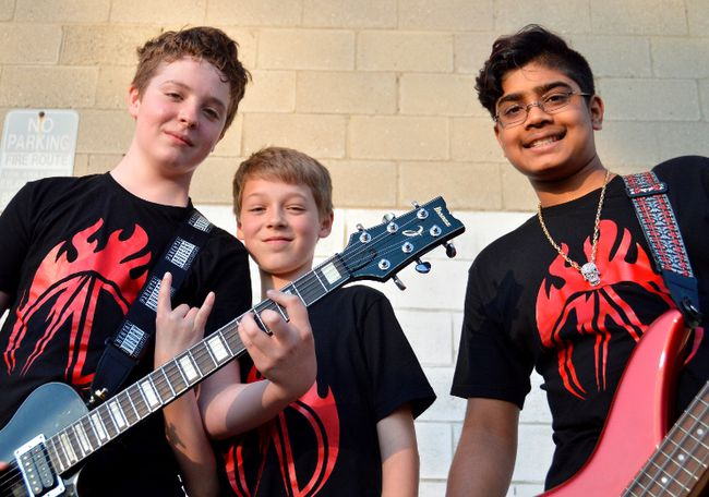 Mason Otte, Adam H. T. Swallowell, and Dinith Nawaratne stand outside the Music Box, an east end banquet hall where they practice. The young band is quietly amassing a following in London, winning last year's London's Got Talent and the more-recent Jack Richardson High School Battle of the Bands. LOUIS PIN/Postmedia News