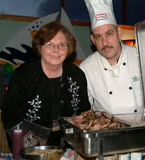 Ella-Jean Richter gets a peek of rosemary encrusted lamb chops prepared by Charles Crouthers, chef at Bridges at Holiday Inn, in this 2005 photo. Richter, who was vice-chair of Sault College's board of governors at the time, was taking part in Savour the Night, a college fundraiser.  (Sault Star File Photo)