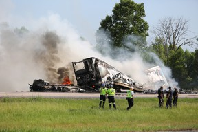 Emergency services on the scene of a tractor trailer crash and fire in the westbound lanes of Highway 401 near Tyendinaga.  Meghan Balogh, Kingston Whig-Standard, Postmedia Network