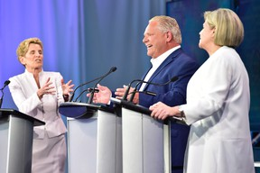 Ontario Liberal Leader Kathleen Wynne, left to right, Ontario Progressive Conservative Leader Doug Ford and Ontario NDP Leader Andrea Horwath participate during the third and final televised debate of the provincial election campaign in Toronto on May 27. THE CANADIAN PRESS/Frank Gunn