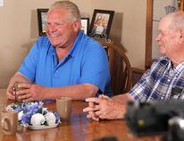 PC Leader Doug Ford shares a laugh will Linda and Bill Reid at their Plympton-Wyoming farm during a campaign stop Wednesday. NDP leader Andrea Horwath was also scheduled to visit the Sarnia-Lambton riding later that day. (Tyler Kula/Sarnia Observer)