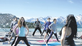 Kaeleigh Doherty and Trish Tutton teach a class at the Banff Gondola on Sunday. Photo courtesy of Curtis James for Banff Yoga Festival.