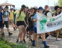 West Ferris Secondary School students march Wednesday along the North Bay waterfront in the 25th annual Trojans March for Cancer. PJ Wilson/The Nugget