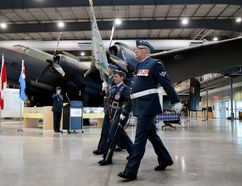 Tim Miller/The Intelligencer The colours for the re-born 434 Operational Test and Evaluation (OT&E) Squadron are carried past the Halifax bomber at the National Airforce Museum of Canada on Thursday in Quinte West. The newly re-born squadron will oversee testing and evaluation elements throughout the Royal Canadian Air Force.