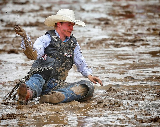 FILE PHOTO Fox Creek cowboy Hunter Sawley is tossed off a horse named Yellow Coconut during the novice saddle bronc event at last year's Calgary Stampede.