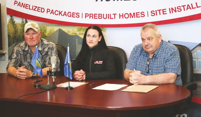 Milo mayor Scott Schroeder, left, Carleen Grant of Nelson Homes and Albert Headrick, administrator for the Village of Milo, at the launch of the Milo/Nelson Gateway Home Lottery at the Village of Milo's office May 18. Jasmine O'Halloran Vulcan Advocate