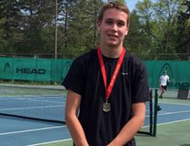 Leyton Baserin wears the gold medal he won at the EOSSAA tennis championships. (Contributed photo)