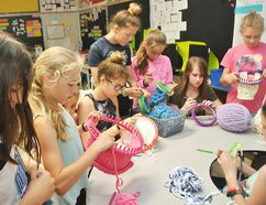 McNaughton Avenue Public School students Ava Parry, Eva Phair, Blair Saunders, Jordyn Butcher, Catherina Picard, Sadie Hamilton, Hannah Babb-Wagner, Hallie Polkinghorne and Aeowyn Dunlop knit hats for babies born at the Chatham-Kent Health Alliance during their knitting club at the Chatham school May 30. Tom Morrison/Chatham This Week