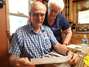 Brian and Donnajean McLeod look back at articles from the tornado on June 2, 1998. (Chris Funston/Sentinel-Review)